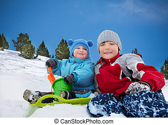 Two brothers having fun on winter day