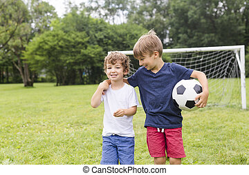 Two brothers having fun playing with ball
