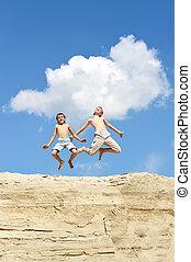 Two brothers jumping