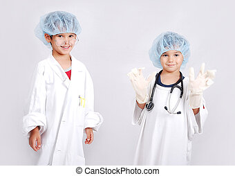 Two brothers playing doctor give medicine to patient