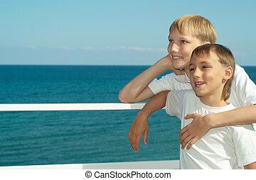 Two brothers sitting in yacht