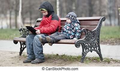 Two brothers with tablet computer