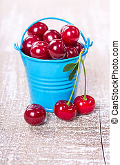 Two buckets with a cherry