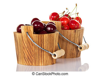 Two buckets with red and pink sweet cherry