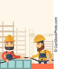 Two builders - A two hipster builders wearing hard hat for...