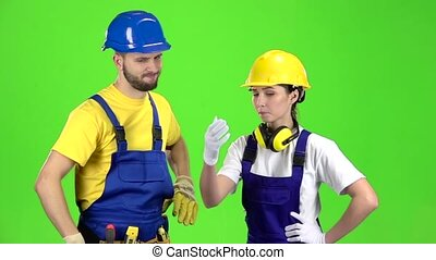 Two builders are disappointed by the loss in the tender. Green screen. Slow motion