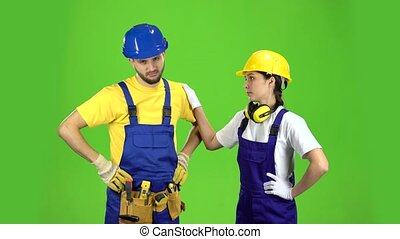 Two builders are disappointed by the loss in the tender. Green screen