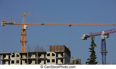 Two building cranes