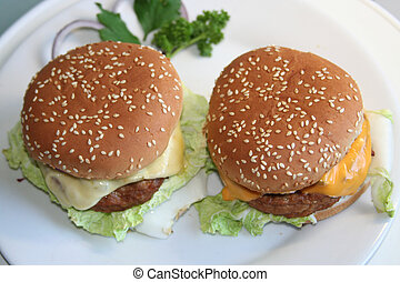 two burgers top-down - two cheeseburgers on white plate ,...