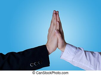 two business hands symbolize success