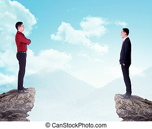Two business man standing on the top of the mountain
