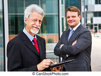 Two business men with a tablet