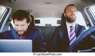business men working with pc in car