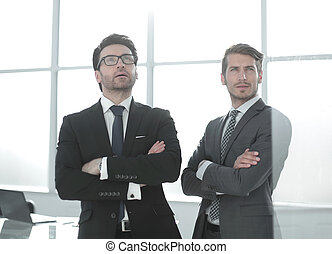 two business partners are looking at a copy of the space