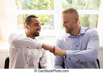 Two Business Partners Making Fist Bump