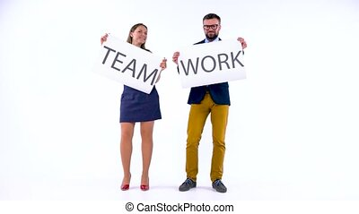 Two business partners posing in the studio with placards in hands. The concept of teamwork