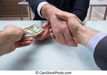 Two Business Partners Shaking Hand At Workplace