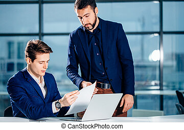 business partners working with laptop together