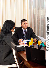 Two business people at meeting