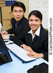 Two business people facing camera