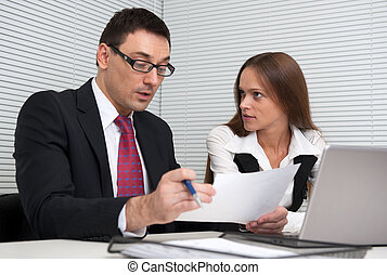 two Business people Having Meeting In Office