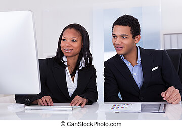 Two Business People In Office - Portrait Of Happy Business...