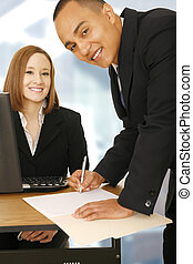 Two Business People In Office Working