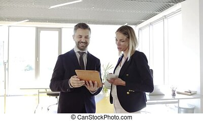Two business people in the office working together.