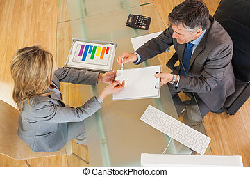 Two business people negociating in an office