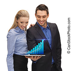 two business people showing tablet pc with graph - two...