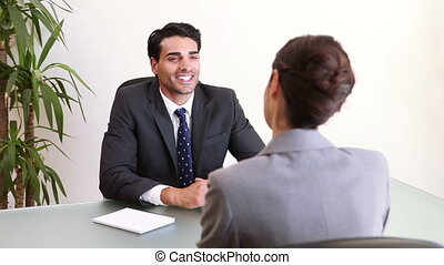 Two business people talking during an interview