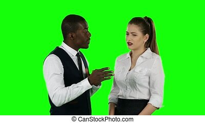 Two business people talking face to face. Green screen