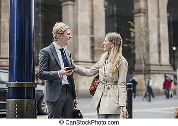 Two Business people Talking on the Street