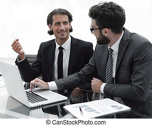 two business people working on laptop.