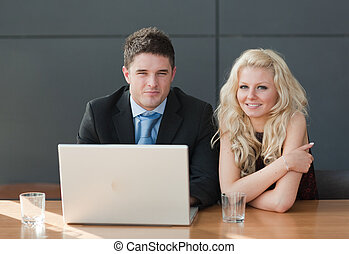 Two Business people working together