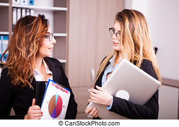 Two business persons meets in the office