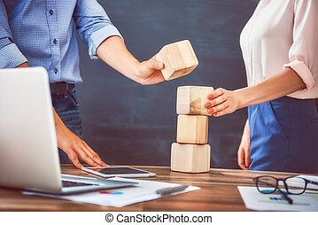 Two business persons plan a project. Team work in office.
