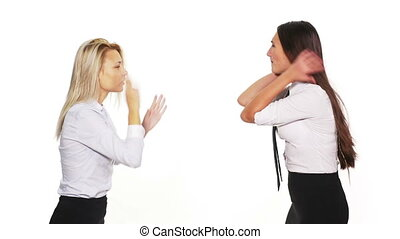 Two business women arguing and getting into a fight