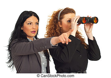 Two business women with binocular