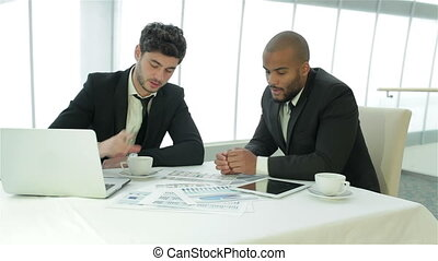 Two businessman discussing documents