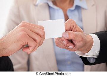 Two Businessman Exchanging Visiting Card