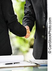Two businessman handshake