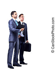 Two businessman looking at white background