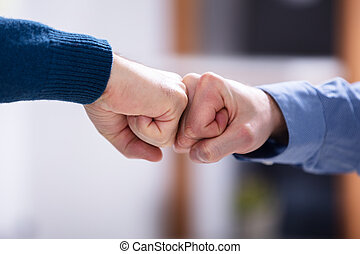 Two Businessman Making Fist Bump