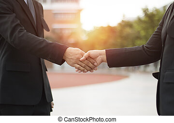 Two businessman shaking hand to negotiate businessman