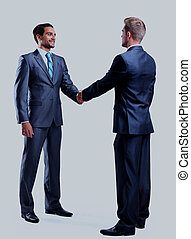 Two businessman shaking hands, isolated on white.