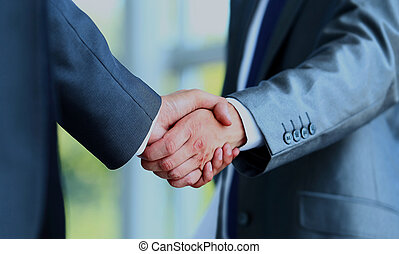 Two businessman shaking hands.