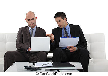 Two businessman working at home.