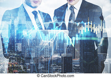 Two businessmans holding laptop computer  with forex charts