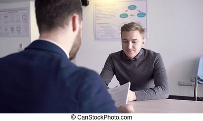 Two businessmen are having business negotiations in modern...